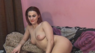 Busty redhead chick fingers her wet pussy Thumbnail