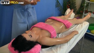 Sweet brunette is fingerbanged on the massage table Thumbnail