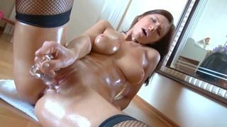 Leggy brunette rubs her pussy in fishnet stockings Thumbnail