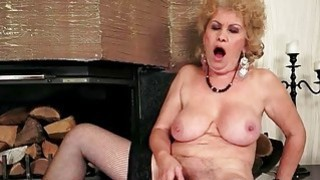 Naughty busty granny in stockings masturbating