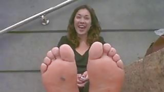 Cutie In Rubber Shoes Teases Feet Thumbnail