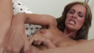 Busty MILF fingers and dildos her pussy