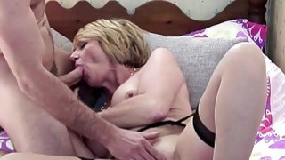 Lusty Busty mature fucks a young stud