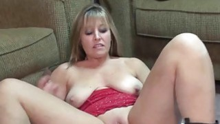 Liisa stuffs a big black dong into her twat