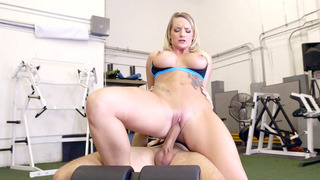 Busty, inked blonde Cali Carter rides massive dong in the gym Thumbnail