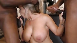 Busty MILF Amber Lynn Bach is more than able to satisfy multiple black cocks Thumbnail