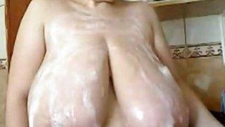 Milf puts foam on her huge tits on webcam Thumbnail