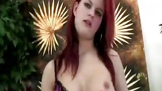 Sexy redhead babe with huge tits fucks lover's asshole with a strapon