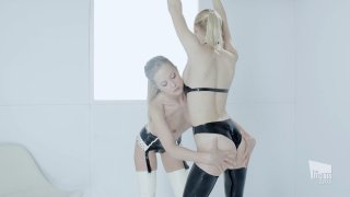 Seductive blonde lesbians in latex play with big sex toys Thumbnail