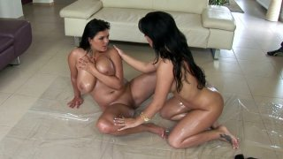 Two hottest chicks in the porn industry Jasmine Black and Amanda Black are rubbing each other's bodies with oil Thumbnail